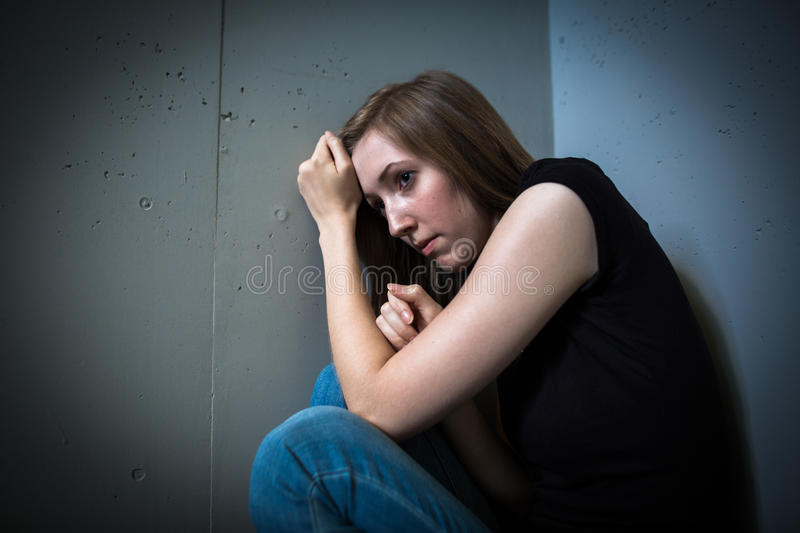 Young woman suffering from a severe depression royalty free stock images