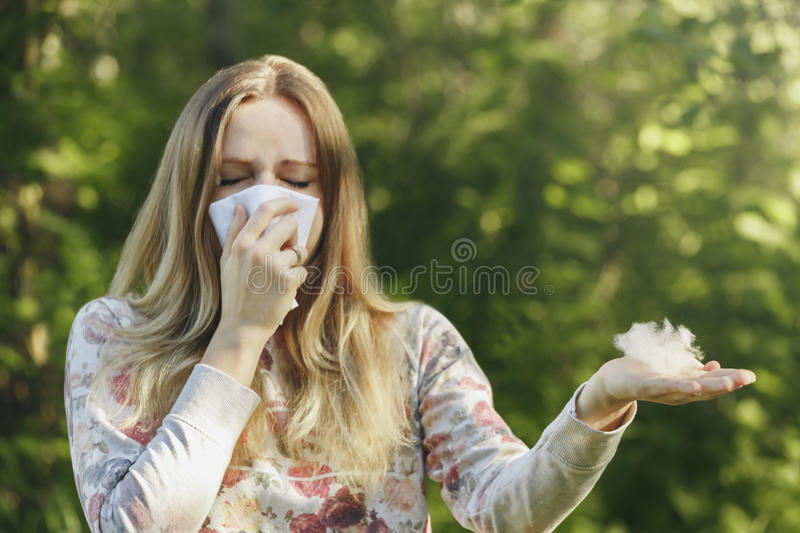Young woman suffering spring pollen allergy stock image