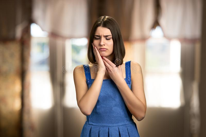 Young woman suffering from tooth pain. stock photography