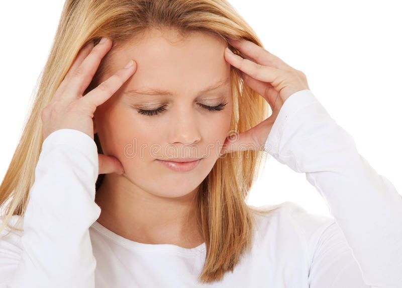 Young woman suffers from headache stock images