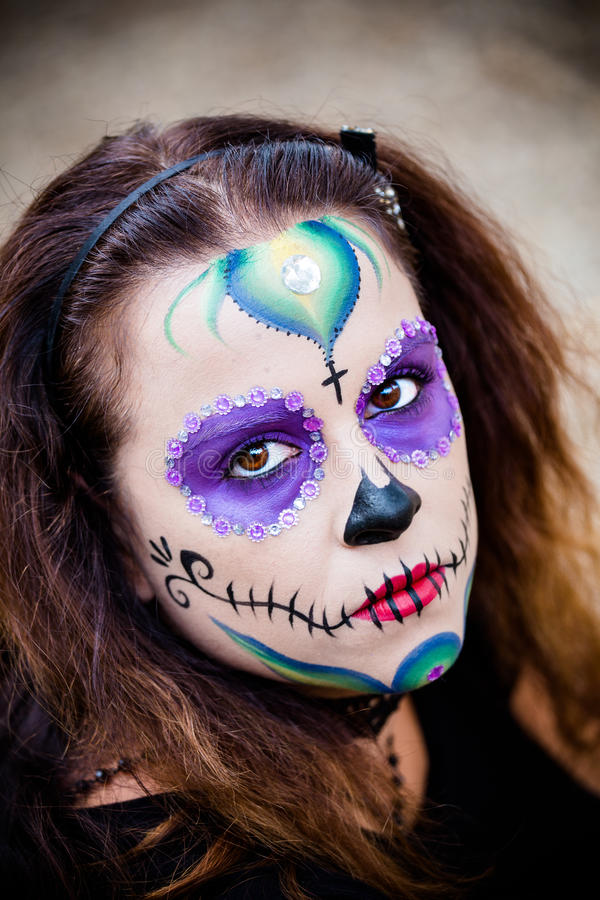 Young woman with sugar skull makeup. Attractive young woman with sugar skull makeup royalty free stock image