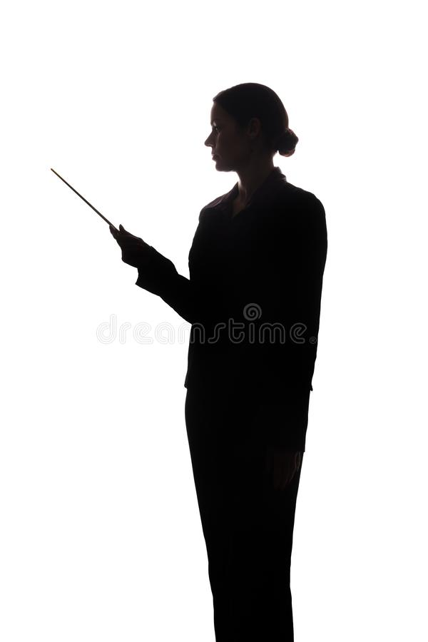 Young woman in suit shows pointer forward, side view - silhouette royalty free stock image