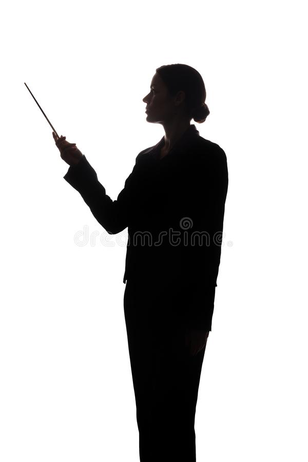 Young woman in suit shows pointer forward, side view - silhouette royalty free stock photography