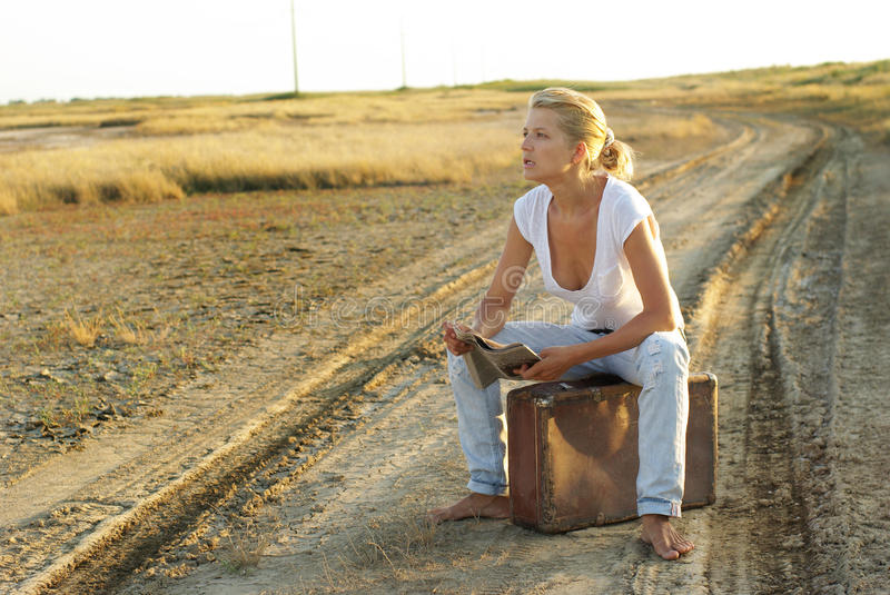 Download Young Woman With A Suitcase Stock Photo - Image of travel, person: 20505656