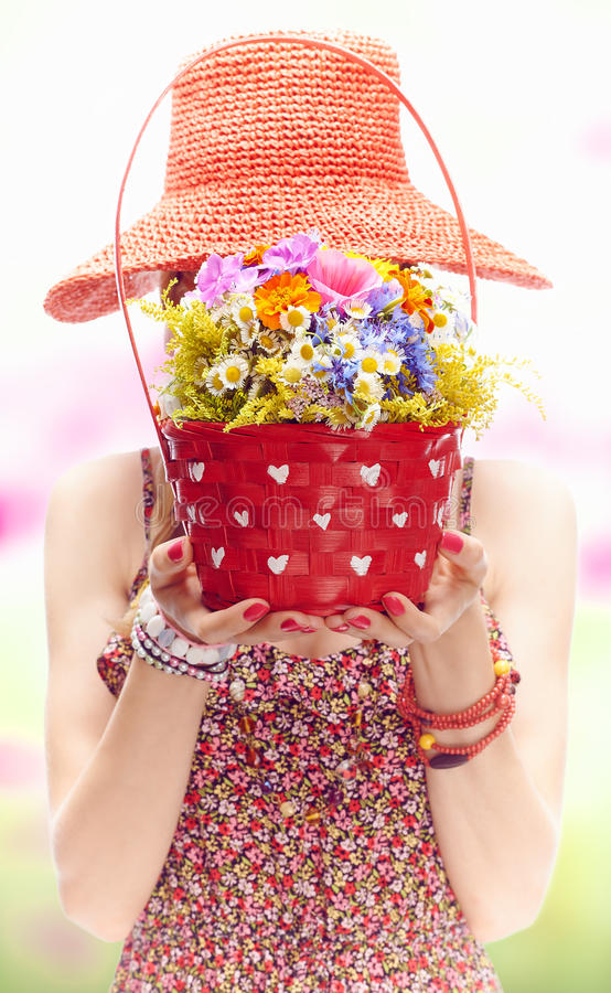 Young woman on the summer meadow with basket of stock images