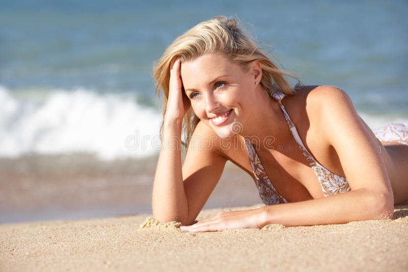 Download Young Woman Sunbathing On Beach Royalty Free Stock Image - Image: 16615296