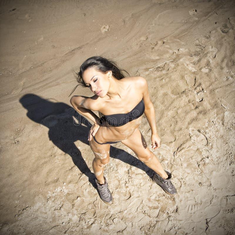 Young woman sunbathing in bikini stock images