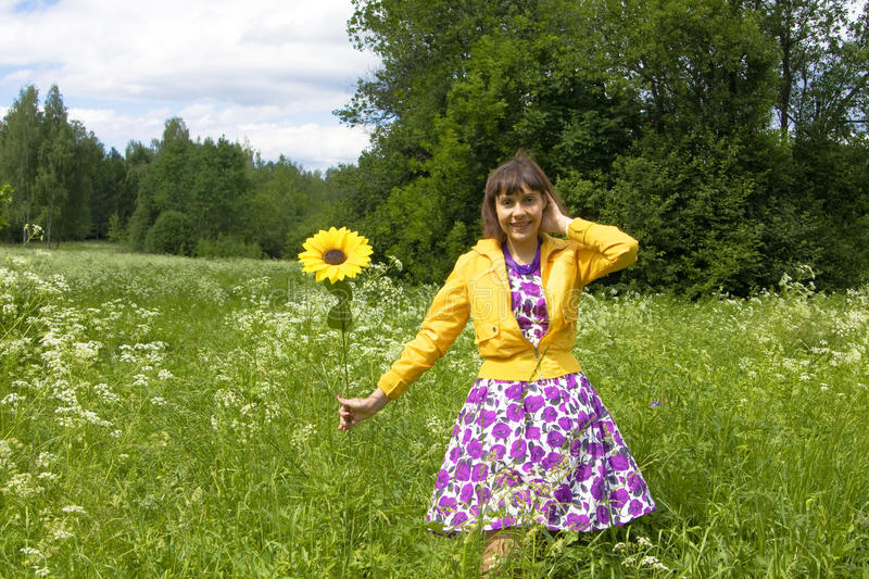 Young woman with sunflower stock image