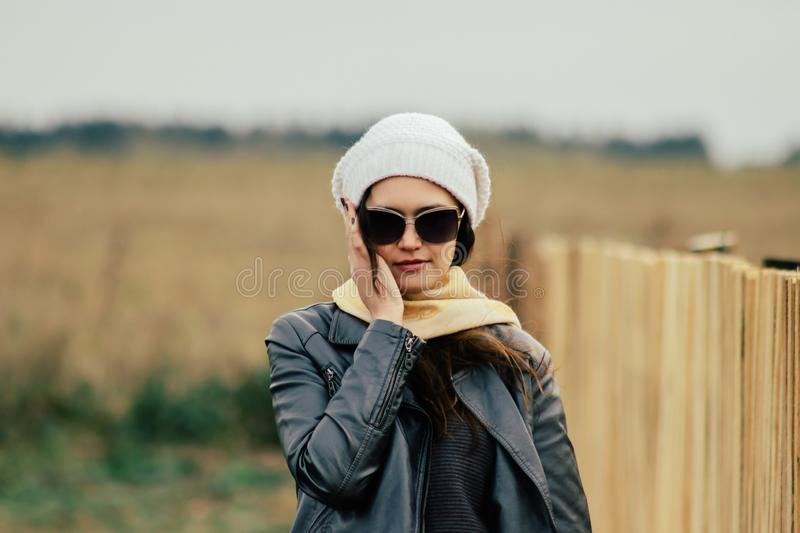 Young woman in sunglasses on rural background royalty free stock image