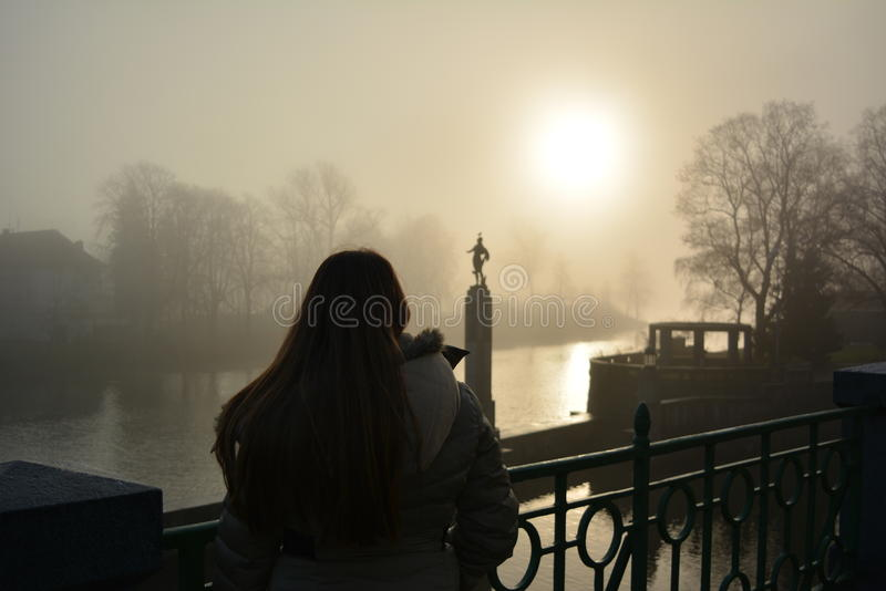 Young woman at sunset on the Charles Bridge stock photography