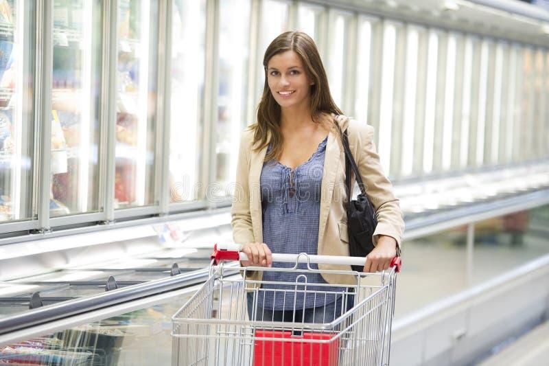 Young woman at supermarket stock photos
