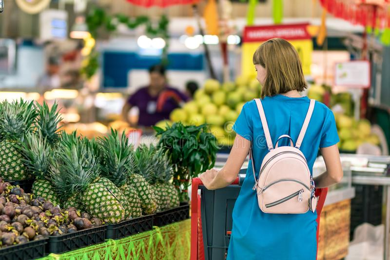 Young woman in supermarket on Bali island. royalty free stock photos