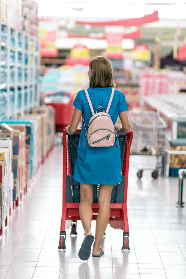Young woman in supermarket on Bali island. Indonesia royalty free stock photography