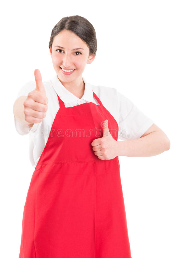 Young woman supermarket employee showing thumbs up royalty free stock photography