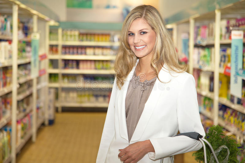 Young woman in supermarket stock photos