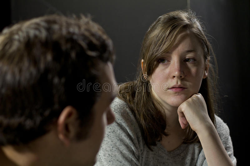 Young woman at a support group listening to man's testimony royalty free stock photos