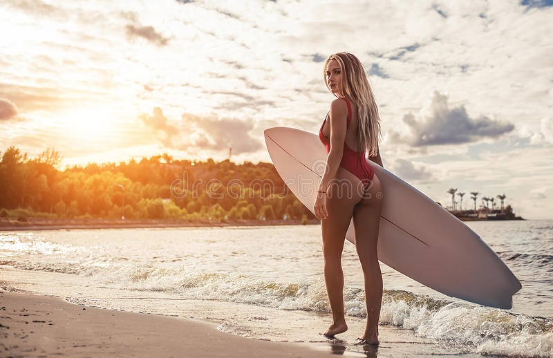 Young woman with surfboard royalty free stock images