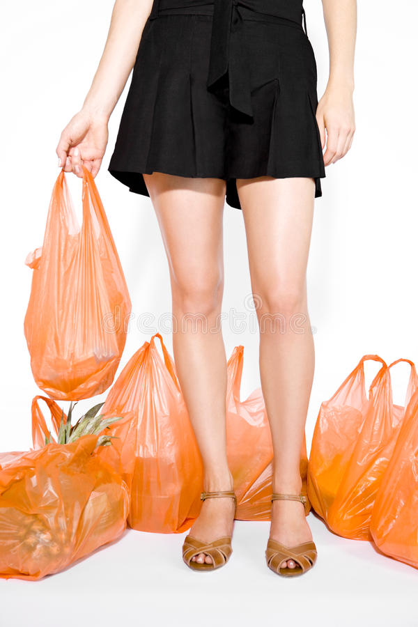 A Young Woman Surrounded By Shopping Bags royalty free stock photography