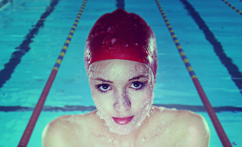 Young woman with swim cap royalty free stock images