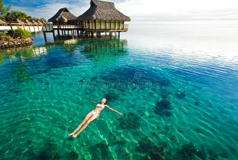 Young woman swimming in a coral lagoon stock photos