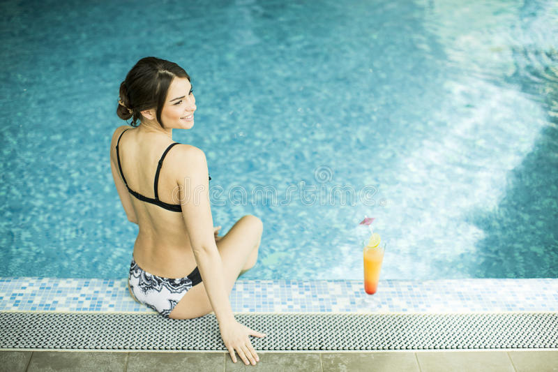 Young woman in the swimming pool royalty free stock image