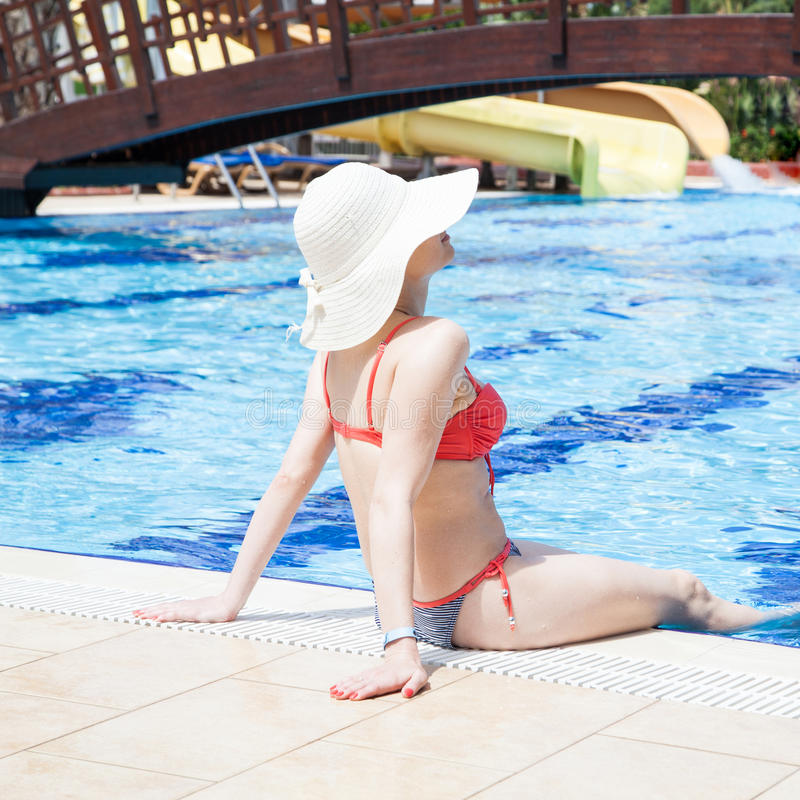 Young woman at the swimming pool royalty free stock photos