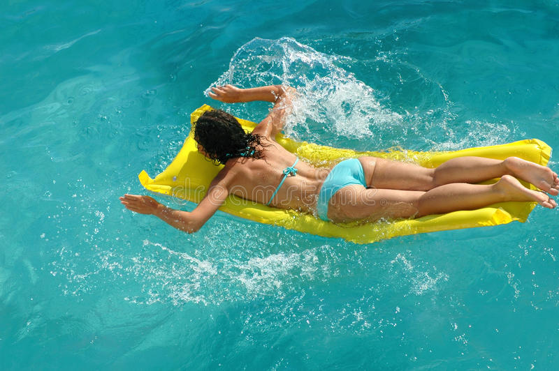 Young woman swimming in water pool royalty free stock photo