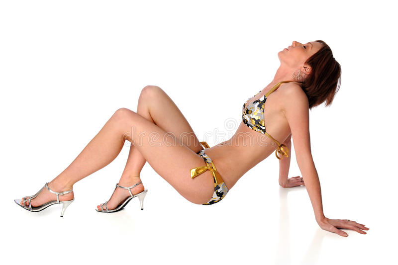 Young Woman in Swimsuit. Isolated over white background royalty free stock images