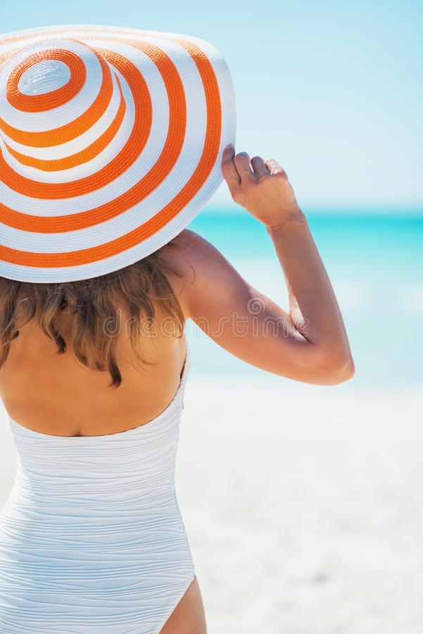 Download Young Woman In Swimsuit Beach Hat Looking Into Distance Stock Photo - Image: 34581856