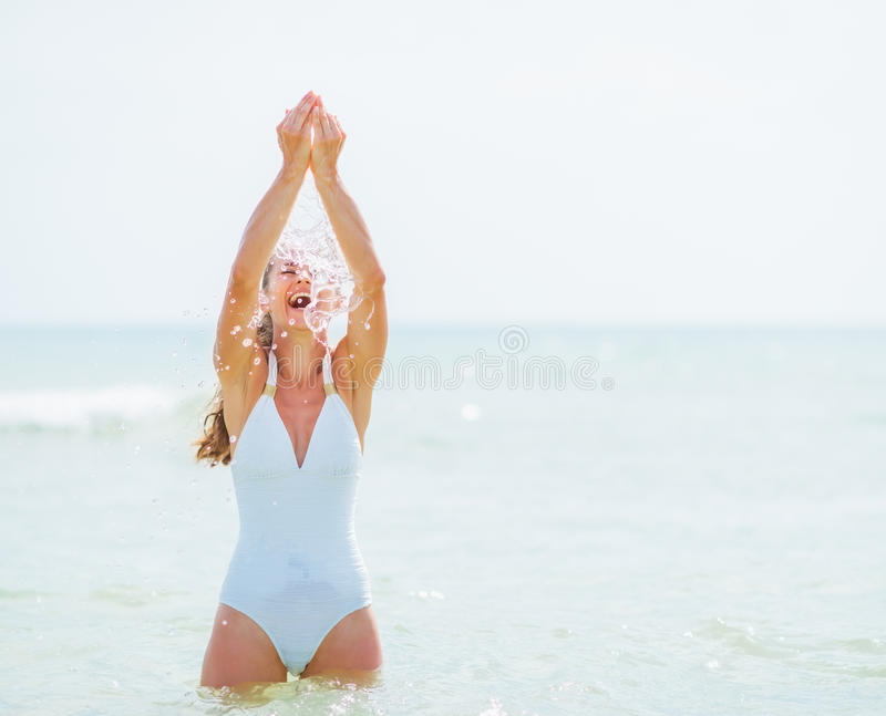 Young woman in swimsuit enjoying sea water royalty free stock photography