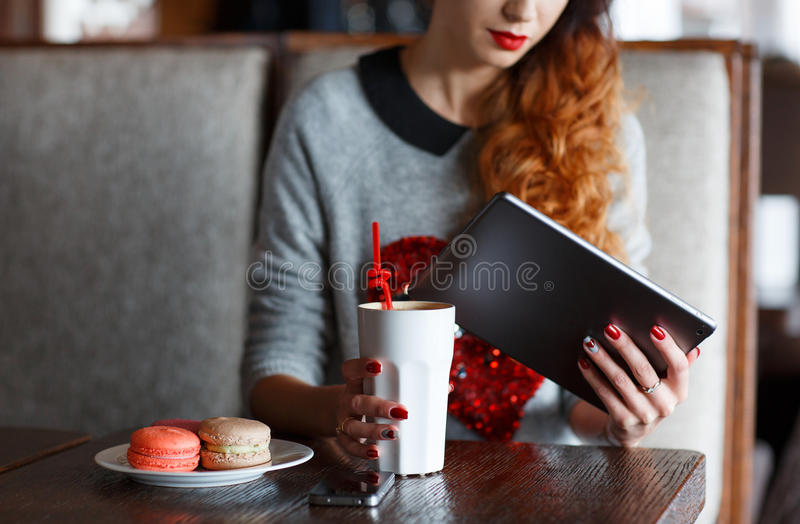 Young woman with tablet computer in cafe stock images
