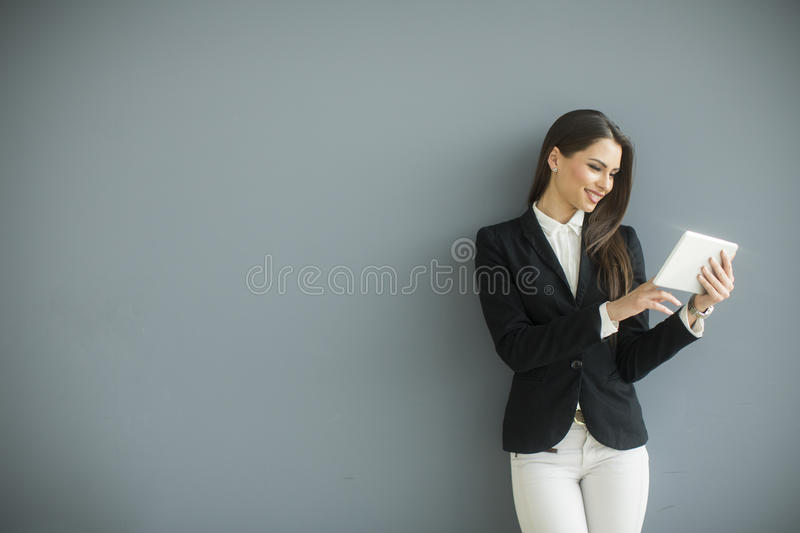 Young woman with tablet royalty free stock image