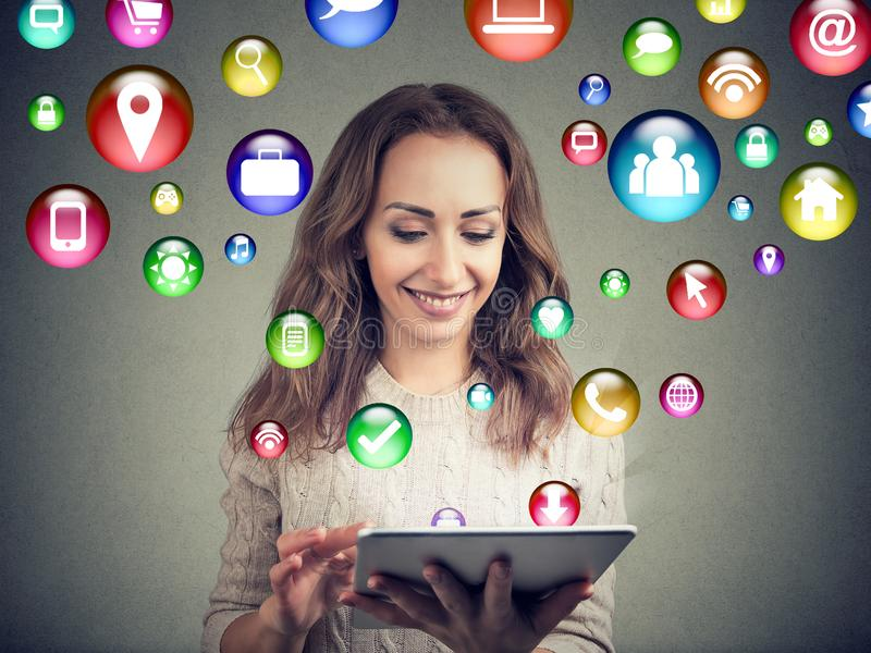 Content young woman using tablet royalty free stock photos