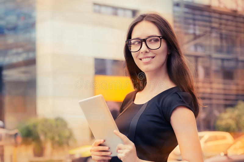 Young Woman with Tablet Out in the City royalty free stock images