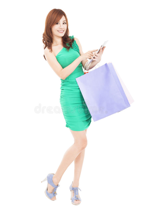 Download Young woman with tablet pc stock photo. Image of buying - 29597068