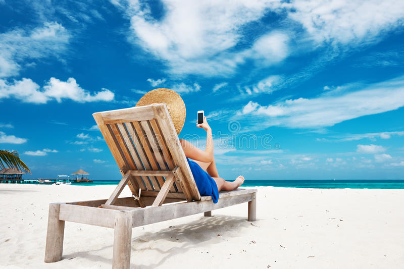 Young woman with tablet pc at the beach royalty free stock photos