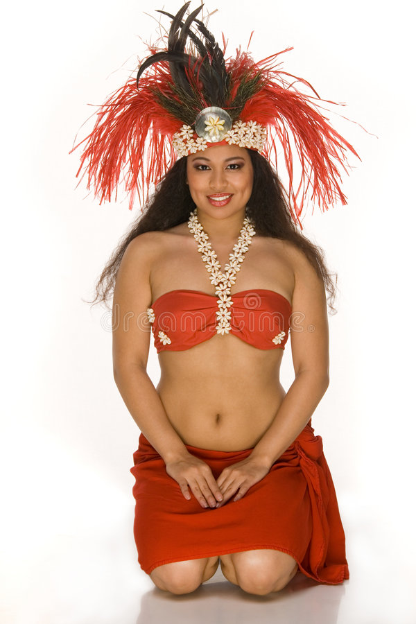 Young woman in Tahitian feather headdress royalty free stock photography