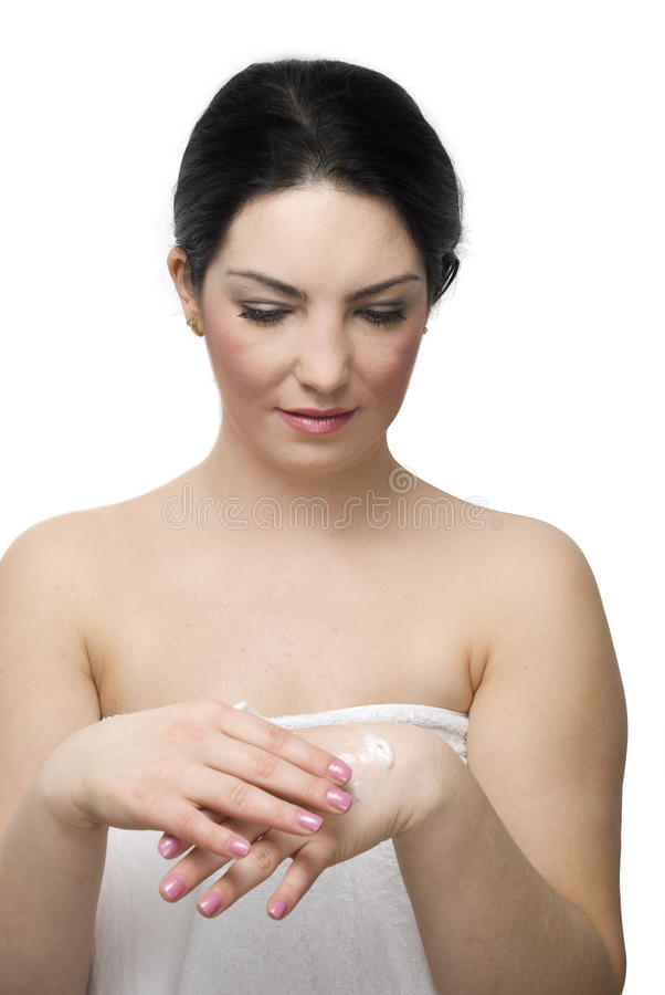 Young woman take care of her hands with cream royalty free stock photography
