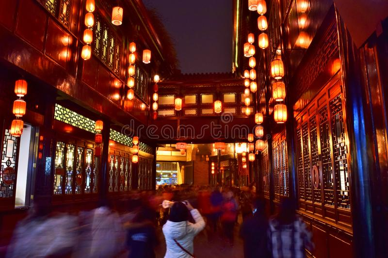 Historic Jinli Walking Street at Night - Chengdu, China. Young Woman Takes a Photo of Chinese Lanterns Hanging from Old Traditional Buildings Along Chengdu`s royalty free stock photo