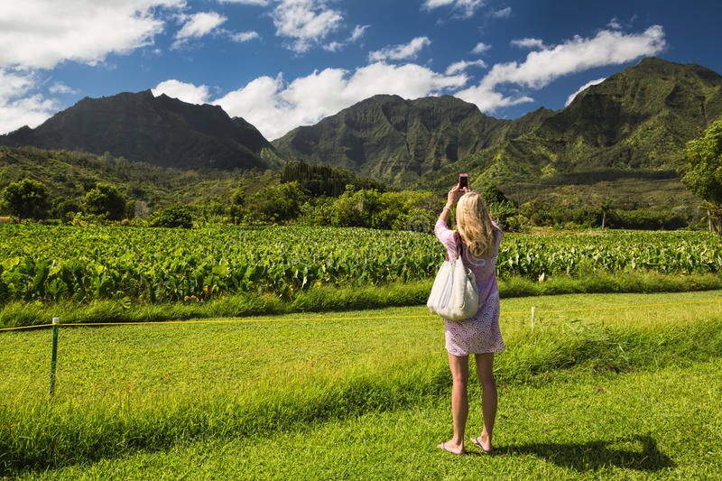 Young Woman Taking Cellphone Picture, Kauai, Hawai Editorial Image