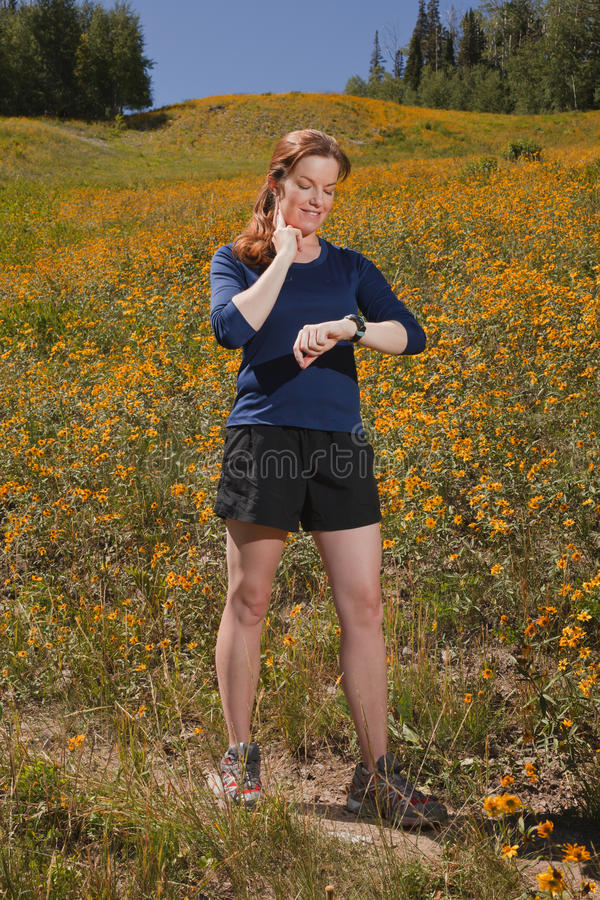 Young Woman Taking Heart Rate While Exercising. Stock Images