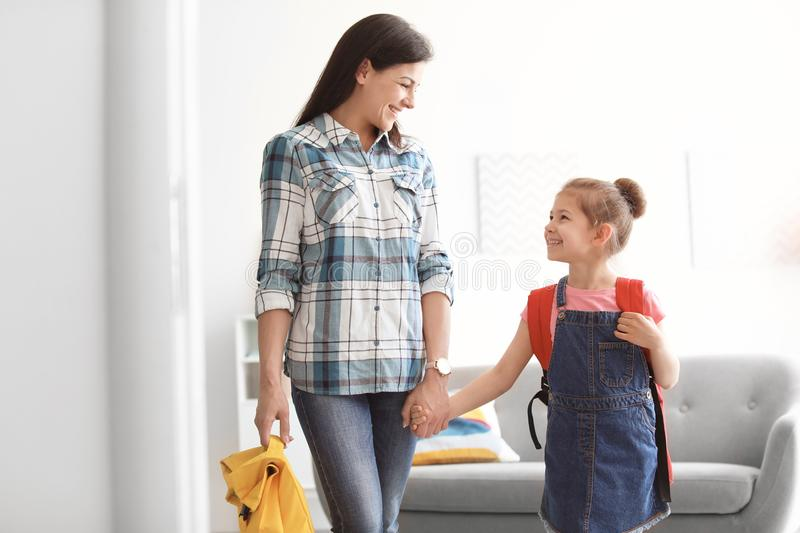 Young woman taking her little child. Young women taking her little child to school stock images