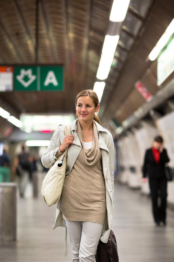 Young woman taking the metro/subway. Elegant, smart, young woman taking the metro/subway royalty free stock photos