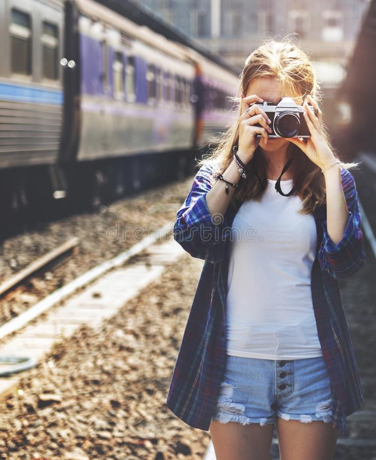 Young woman is taking photo with film camera royalty free stock image