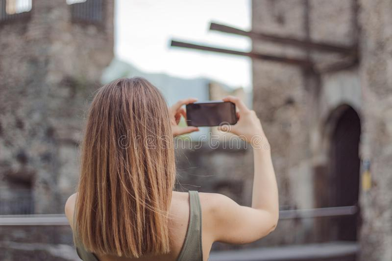 Young woman is taking a picture of a castle stock image