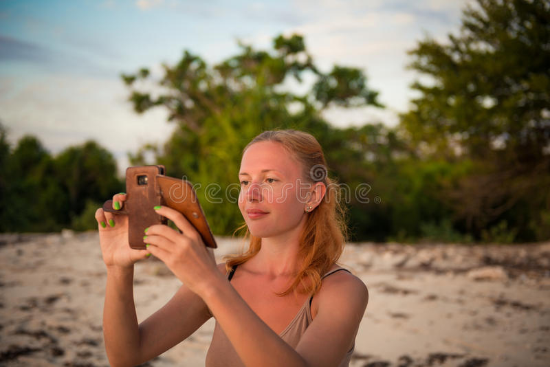 Young woman taking picture stock photography