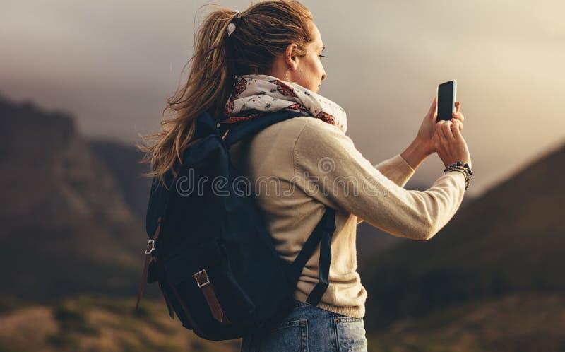 Capturing landscape view for her social media stock images