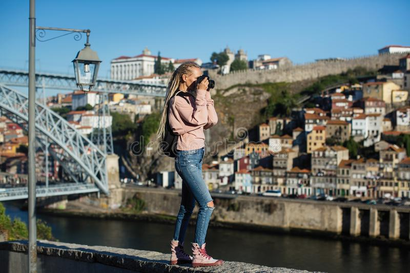Young woman taking pictures of Douro river, Porto stock images