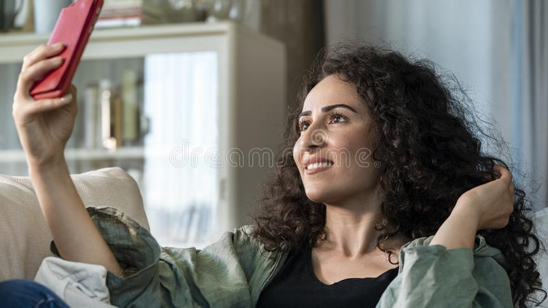 Young woman taking selfie with mobile phone stock images