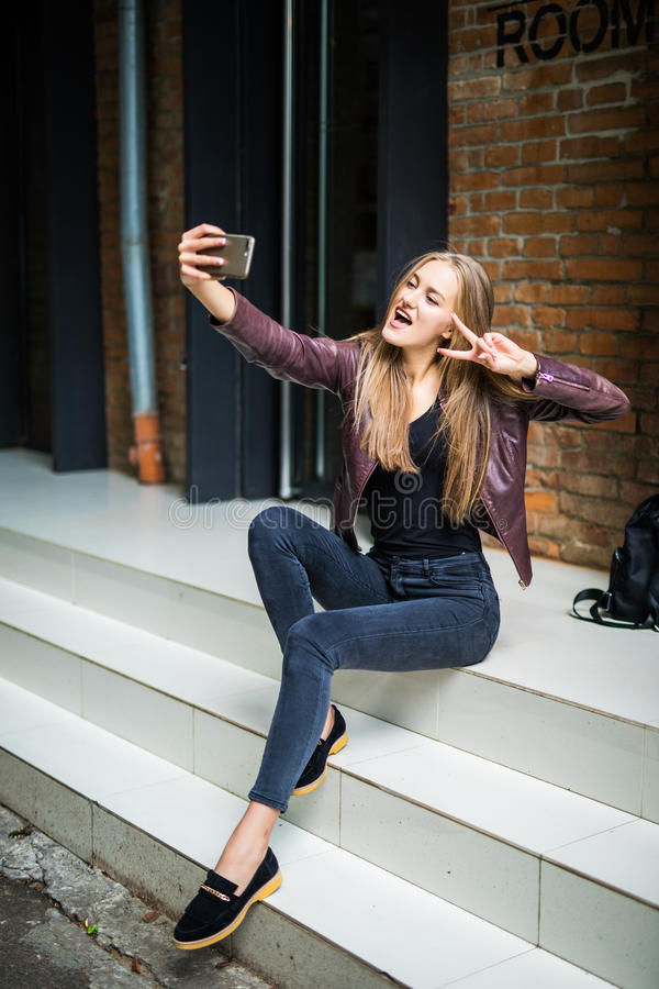 Teacher Taking Cell Phone Away From Teenage Girl High-Res